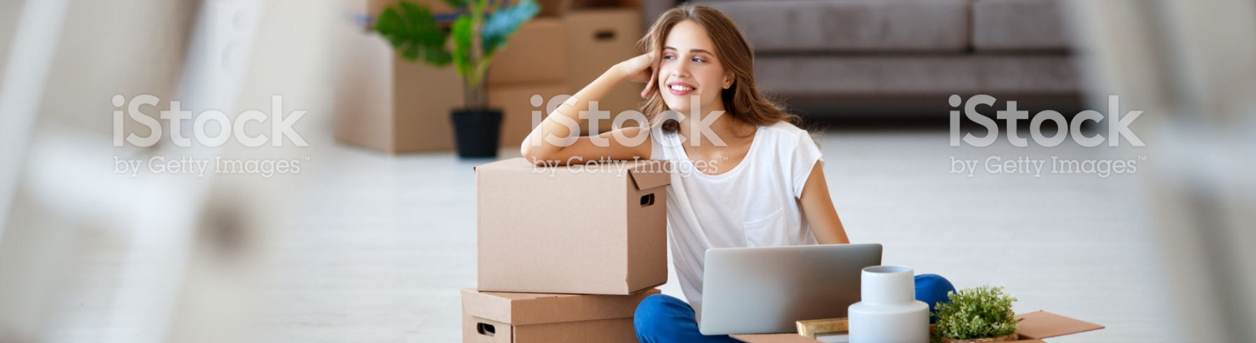 woman smiling leaning on box