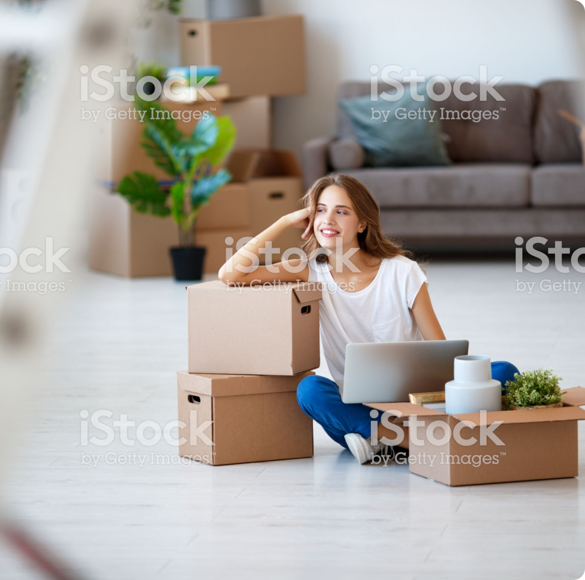 smiling woman leaning on a box